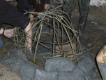 The frame of our bread oven, with the first lift of clay blocks in place.