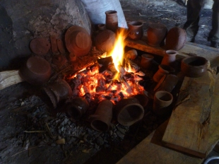 The pots sitting round the fire. Notice the oily sheen on some, an experiment into the effect of beeswax and other substances on the finish.
