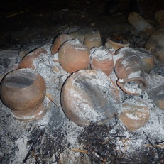 A fine covering of ash covers the mound of pots.
