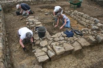 volunteers excavating the bodies