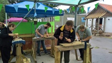 Saxon woodcarvers take cover from the anger of the gods