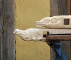 carved heads for trestles. Top one finished.